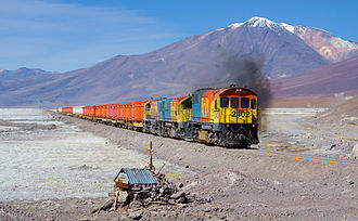 Ferrocarril de Antofagasta a Bolivia - EMD GR12 2402, EMD/Clyde GL26C-2 2010 and EMD/Clyde GL26C-2 2005 crossing the Salar de Ascotán, with Cerro del Azufre in the background