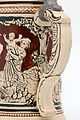 Faience beer stein with ball scene on brown background 12.jpg