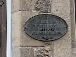 Photo of John Meade Falkner black plaque