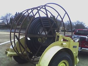 Fiber-optic communication - A cable reel trailer with conduit that can carry optical fiber