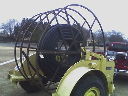 A cable reel trailer with conduit that can carry optical fiber Fiber optic3.jpg