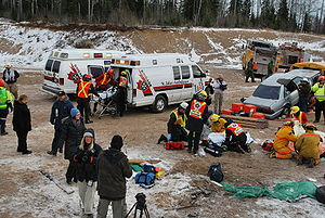 Certified first responder - First Responders from St. John Ambulance and fire departments assist paramedics during an exercise outside Thunder Bay, Ontario, Canada
