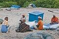 Fisherman preparing their nets at Nagapattinam Beach.jpg