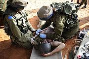"Flickr - Israel Defense Forces - Field Doctors Treat ""Wounded"" During Exercise, Oct 2010"