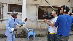 La Sape - A Brazzaville sapeur being interviewed for Spanish documentary filmmakers (2010)