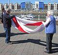 Folding the Jersey flag 2011 4.jpg