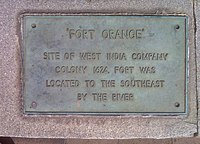 "A metallic plaque with the words ""Fort Orange: Site of West India Company Colony 1624, was located to the southeast by the river."""