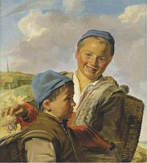 Portrait of two fisherboys with one holding a crab