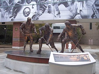 Buffalo Sabres - A statue of the French Connection line stands outside KeyBank Center. Consisting of Gilbert Perreault, Rick Martin, and Rene Robert, they played together from 1972 to 1979.