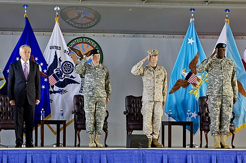 The outgoing Commander of the United States Central Command General James Mattis (second, from right) with the incoming Commander of the United States Central Command General Lloyd Austin (first, from right) during U.S. Central Command change of command ceremony at MacDill Air Force Base, Tampa, Florida, March 22, 2013. Both General James Mattis and General Lloyd Austin would later on served as United States Secretary of Defense, with Mattis served as the 26th Secretary of Defense and Austin served as the 28th Secretary of Defense.