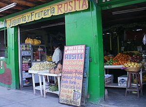 Nazca - A fruit stand with sandwiches open early for breakfast in Nazca near the main farmers market