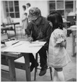G.B. Chiltosky and Graves Child at a Painting Workshop Taught by Mrs. George Bolton. - NARA - 281616.tif