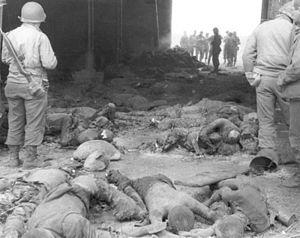 Gardelegen massacre - American soldiers view bodies in barn