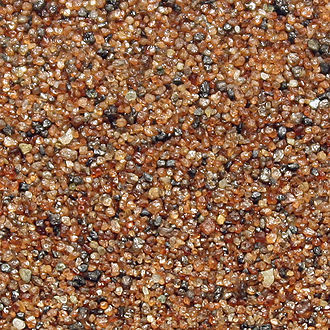 Cape Nome - Heavy mineral sand composed mainly of garnet crystals collected from Cape Nome.