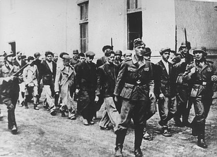 Germans escorting people from Kragujevac and its surrounding area to be executed. German Soldierss arresting in 1941 people in Kragujevac.jpg