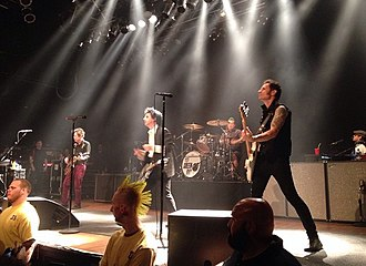 Green Day - Green Day performing in Cleveland, Ohio in 2015. From left to right: Jason White, Billie Joe Armstrong, Tré Cool and Mike Dirnt.