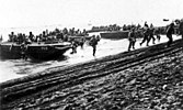 U.S. First Division Marines storm ashore across Guadalcanal's beaches on 7 August 1942
