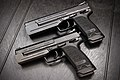 HK USP Elite and Expert 9mm with Merkle Tuning weights (20965366061).jpg