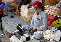 Happy Tailor (5274603493).jpg
