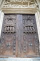High-relief religious figures adorn doors - Eglise Saint-Maclou (30901160355).jpg