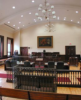 enclosed space in which a judge regularly holds court