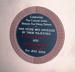 Peel, Isle of Man - Memorial plate at House of Manannan in Peel, from King Harald V and Queen Sonja of Norway (2002)