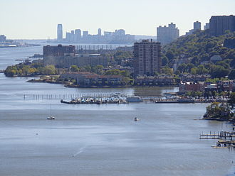 Edgewater, New Jersey - A southward view of Edgewater (foreground) from the George Washington Bridge, with the skyline of Jersey City in the background