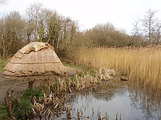 "Mesolithic - Reconstruction of a ""temporary"" house in Ireland; waterside sites offered good food resources."