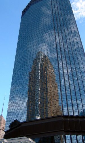 IDS Center - IDS Tower reflecting the nearby Wells Fargo Center