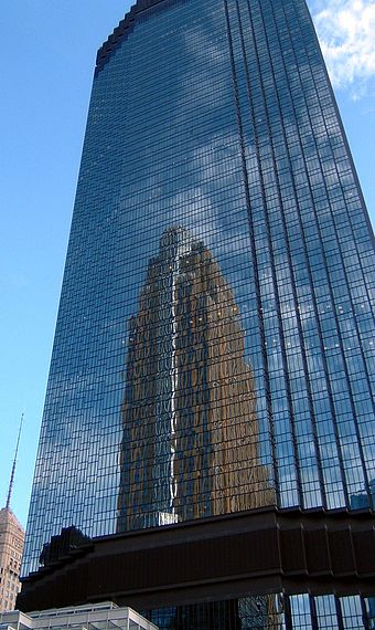 The IDS Tower, designed by Philip Johnson, is the state's tallest building, reflecting Cesar Pelli's Art Deco-style Wells Fargo Center IDS reflecting Wells Fargo.jpg
