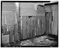 INTERIOR VIEW TO NORTHWEST OF UPRIGHT LOG CONSTRUCTION AT WEST WALL - John Engberg House, Falkirk, McLean County, ND HABS ND,28-FALK,1-5.tif