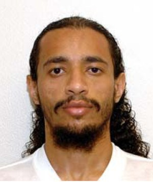 Ahmed Abdul Qader - Guantanamo captive Akhmed Abdul Qadir wearing the white uniform issued to compliant captives.