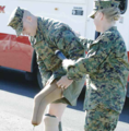 Injured Marine aids Camilla Lawson in traffic safety training.png