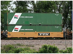 Intermodal shipping containers on a railway fl...
