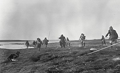 Inuit running to fish for salmon at Nulahugyuk Creek (37078).jpg