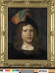 Hoofd van een jonge man met een baret