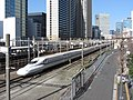 JR Central Shinkansen N700 Series passes Tamachi, Tokyo, Japan 17 03 20 (49669009511).jpg