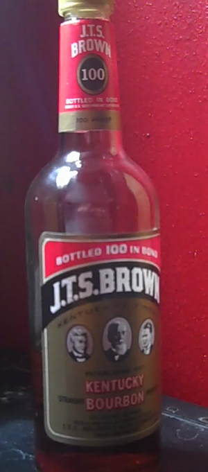Bottled in bond - A 750 ml bottle of J.T.S. Brown Bottled in Bond Kentucky bourbon whiskey. Note the writing in the red banner.