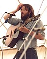 """James Patterson, UK folk musician on stage with """"Crows"""", Towersey, 1980.jpg"""
