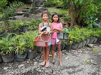 Puto - School children selling puto in Barangay Santa Cruz, Guiguinto, Bulacan.