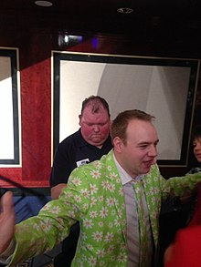 John Henderson signing a fan's Opposuit following his win over Peter Wright.jpg