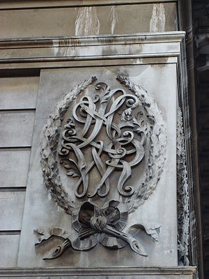 London and North Western Railway - LNWR's initials carved in Portland Stone on one of Euston Station's entrance lodges