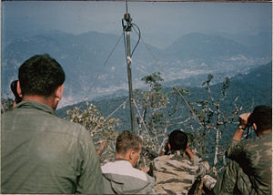 Company E, 52nd Infantry (LRP) (United States) - LRPs on Signal Hill directing artillery on enemy trucks in valley.