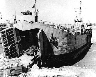 Landing Ship, Tank - USS LST-742 on 13 October 1950 at Wolmi-do island, Inchon Harbor, South Korea, loading supplies for the upcoming Wonsan invasion