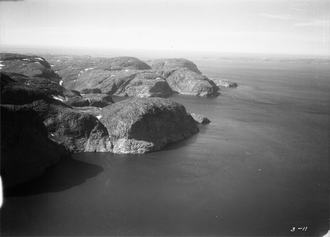 Cape Chidley - Aerial view of coastal cliffs of Cape Chidley with Button Islands visible in distance
