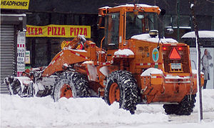 North American blizzard of 2006 - A loader clears snow in New York City during a lull in the snowfall on Sunday, February 12.