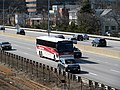 Logan Express Framingham bus on the Mass Pike in Allston, April 2017.JPG