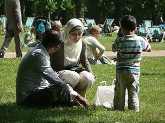 Cultural diversity - People of various cultural background in a park in London