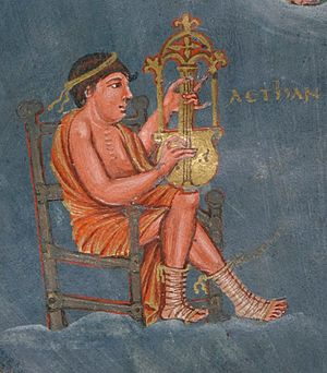 Cythara - Tours, France. A musician playing a cithara that has a neck between the instrument's arms, from the 9th Century Charles the Bald Bible. The arched section at the top is Winternitz's yoke.