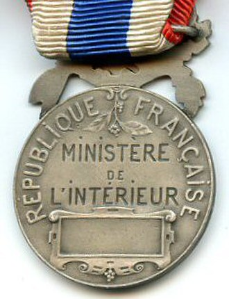 Honour medal of the National Police - Reverse of the Honour medal of the National Police